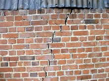 Note how the crack follows the mortar joints and is wider at the top - subsidence again.